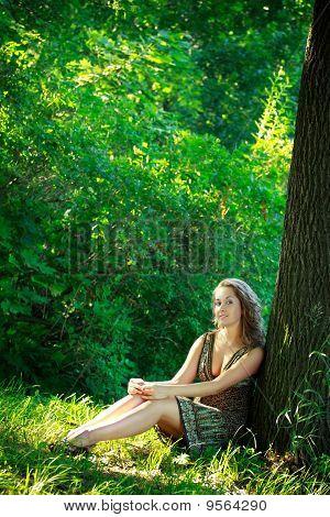 Beautyful Woman Sitting Next Tree