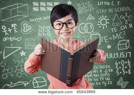Attractive Child With Book And Scribble Background