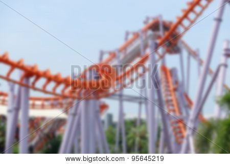 Blurred Railroad Roller Coaster At An Amusement Park.