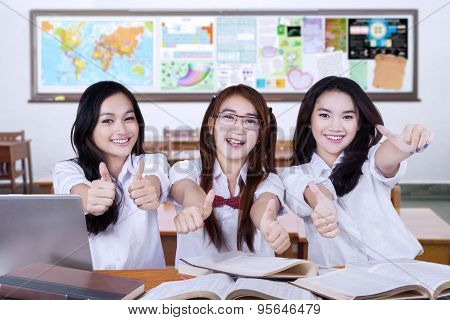 Teenager Students Shows Thumbs Up In Class