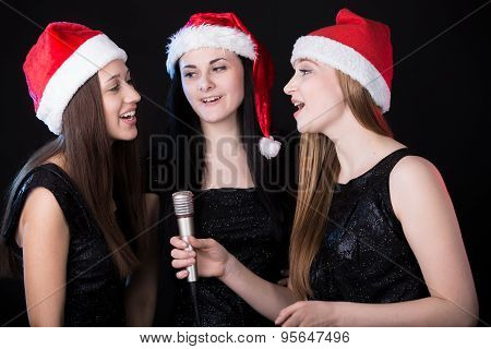 Three Attractive Young Women Singing