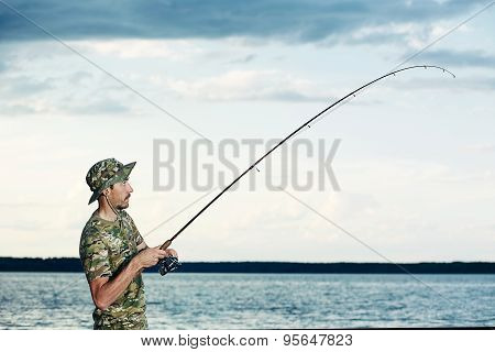 Surprised Man Caught A Fish On The Lake
