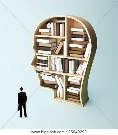 Man Looking At Book Shelf