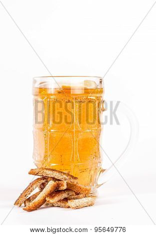 Glass of beer with rusk isolated on a white background