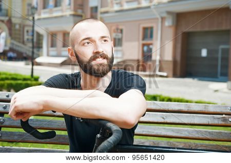 Handsome young hipster guy is having rest