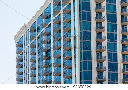 White Balconies On Blue Glass Condominium