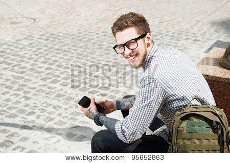 Attractive young tourist with backpack is traveling