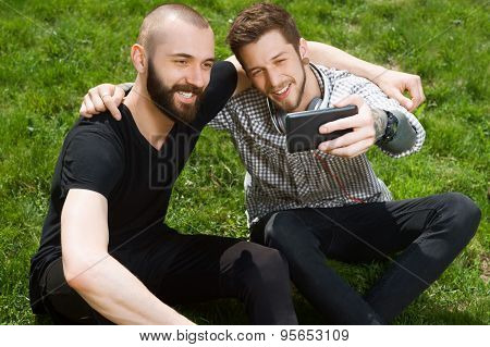 Handsome young hipster guys are making selfie