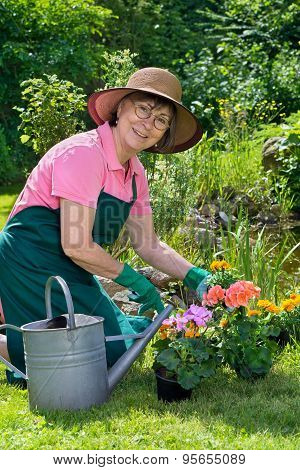 Happy Lady Transplanting Spring Flowers