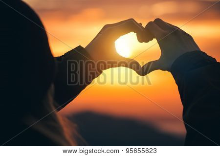 Woman hands Heart symbol shaped silhouette Travel Lifestyle
