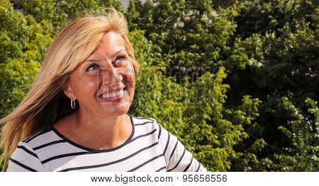 Mature Woman Smiling Looking Up