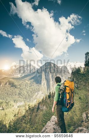 Young Man with backpack relaxing outdoor Travel Lifestyle