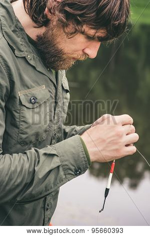 Young Man Fisherman bearded fishing with rod Lifestyle Travel