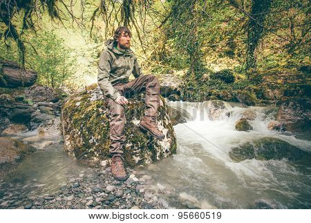 Young Man bearded relaxing hiking outdoor