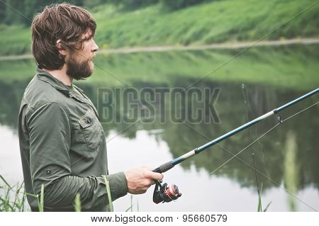 Young Man Fisherman bearded fishing with rod Lifestyle