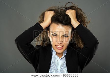Furious Businesswoman Pulling Her Hair