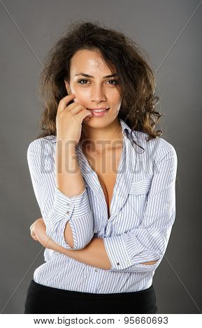 Contemplative Smiling Businesswoman