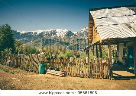 Highland village traditional wooden house and fence with Mountains Landscape