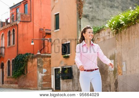 Woman Walking Happily In Venice