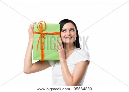 A Brunette Woman Is Holding A Green Gift Box. Isolated.