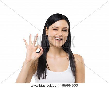 Brunette Woman Shows Ok Sign. Isolated.