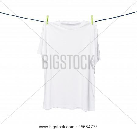 Close Up Of A White T-shirt On The Rope. Isolated On White Background.