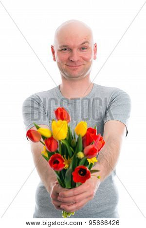 Young Man With Bald Head And Bunch Of Tulips