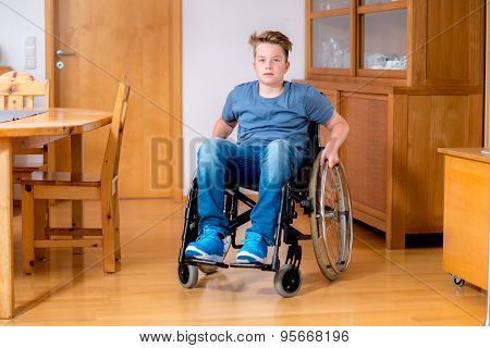 Disabled Boy In Wheelchair At Home