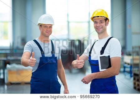 Two Worker In Factory With Thumb Up