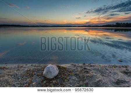 Beautiful Lake At Sunset Landscape With Cloudy Sky Reflecting In Water