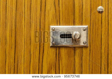 Metal Latch On Wooden Door