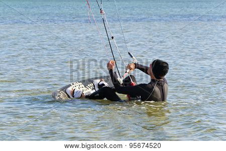 Kite Surfer gets up on the board