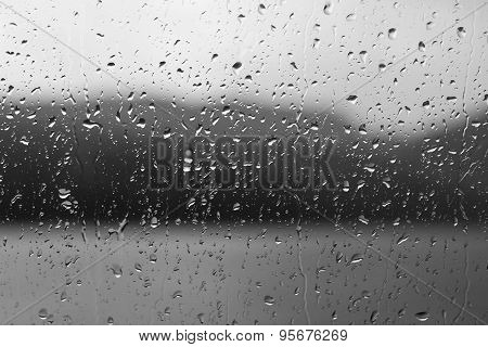 Rain Drops On A Window Or Water Drops On Grass Background