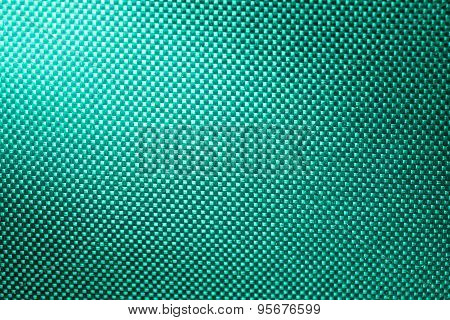 Turquoise Fabric Nylon Background Texture With Light From Corner