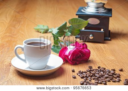 Vintage coffee mill, cup and rose
