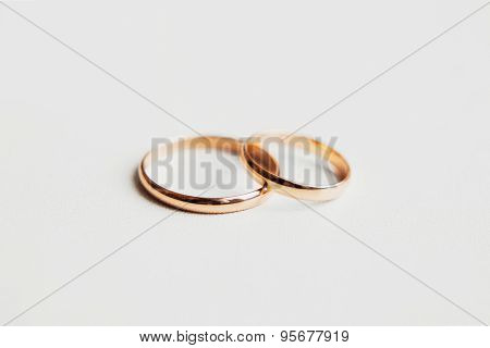 Two golden rings on white background