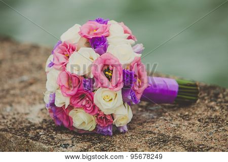 Brides bouquet with purple, pink and white flowers