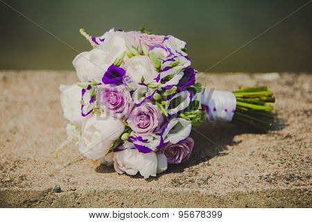 Close up of brides bouquet with colorful flowers on wedding day