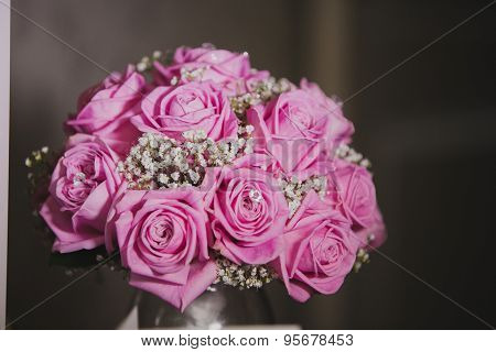 Close up of brides bouquet with pink roses on wedding day