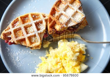 Scrambled eggs with fruit-stuffed waffles