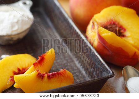 Vintage pan with fresh peach slices