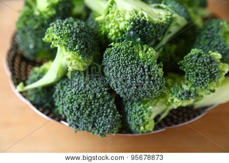 Steamer basket filled with broccoli