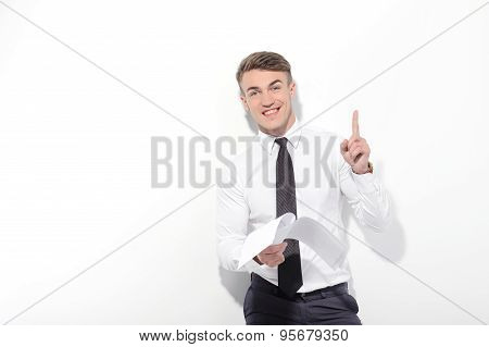 Businessman holding papers and pointing up