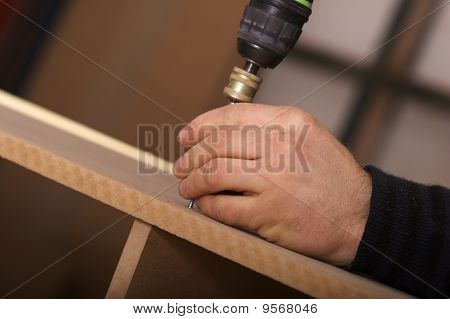 Carpenter Making A Wall Unit