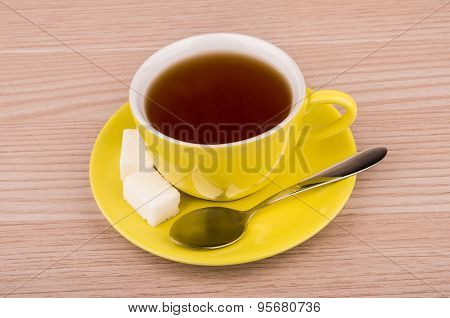 Hot Black Tea In Yellow Cup On Table