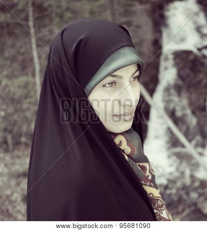 Beautiful Muslim woman in nature