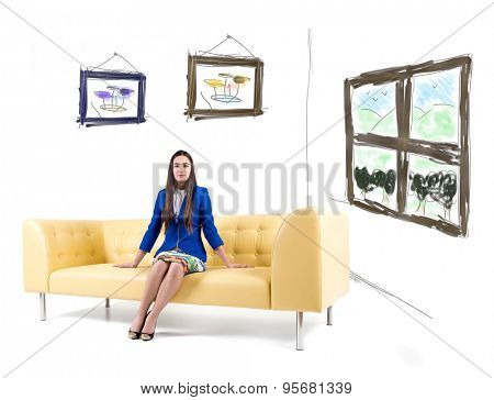 Beautiful woman sitting on couch in dream home