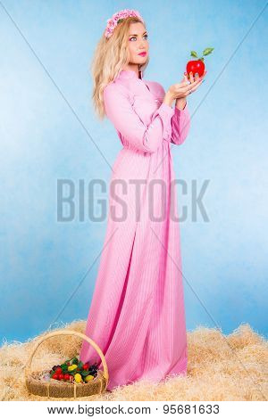 Beautiful Young Blonde In A Long Pink Dress Staying In A Hay