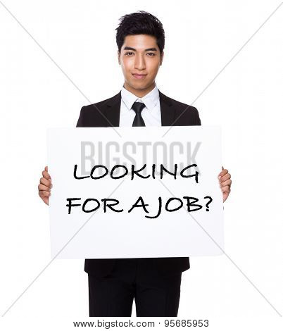 Businessman hold with white card board presenting phrase of looking for a job