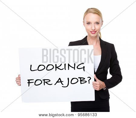 Caucasian businesswoman hold white board with phrase of looking for a job